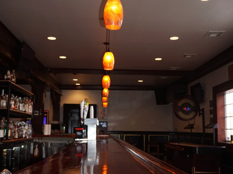 Hanging Lamp Over Bar - A Still Life