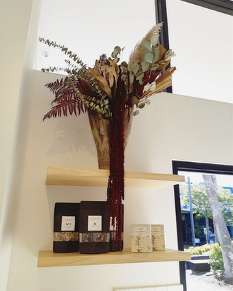 Dried floral arrangement in sculptural seed pod inspired vase