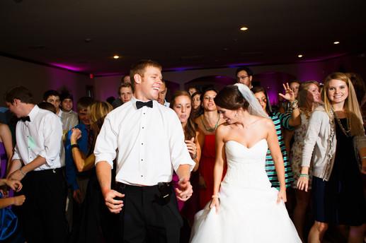 Wedding couple dancing at Vesica Piscis Chapel in Tulsa