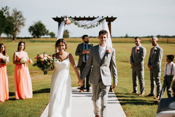 Outdoor wedding at the ceremony the Steel Barn event center.