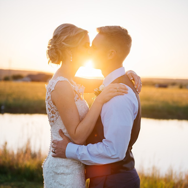 Wedding couple takes sunset photograph after wedding at Bellissima Ranch
