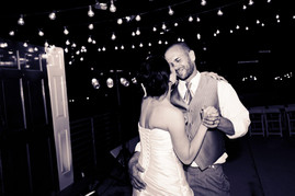Couples first dance under bistro lights for an outdoor wedding in downtown Tulsa