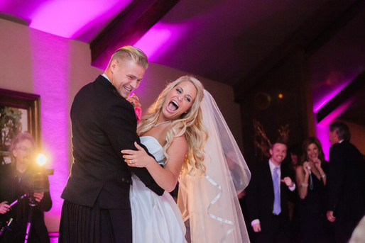 Fun couple enjoying their first dance at the Oaks Country Club in Tulsa