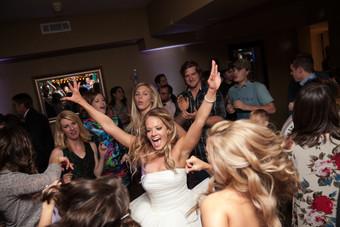Beautiful bride dancing at Dresser Mansion wedding venue in Tulsa