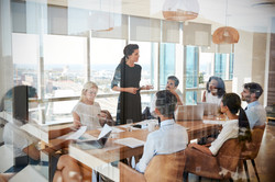 Businesswoman Leads Meeting Around Table