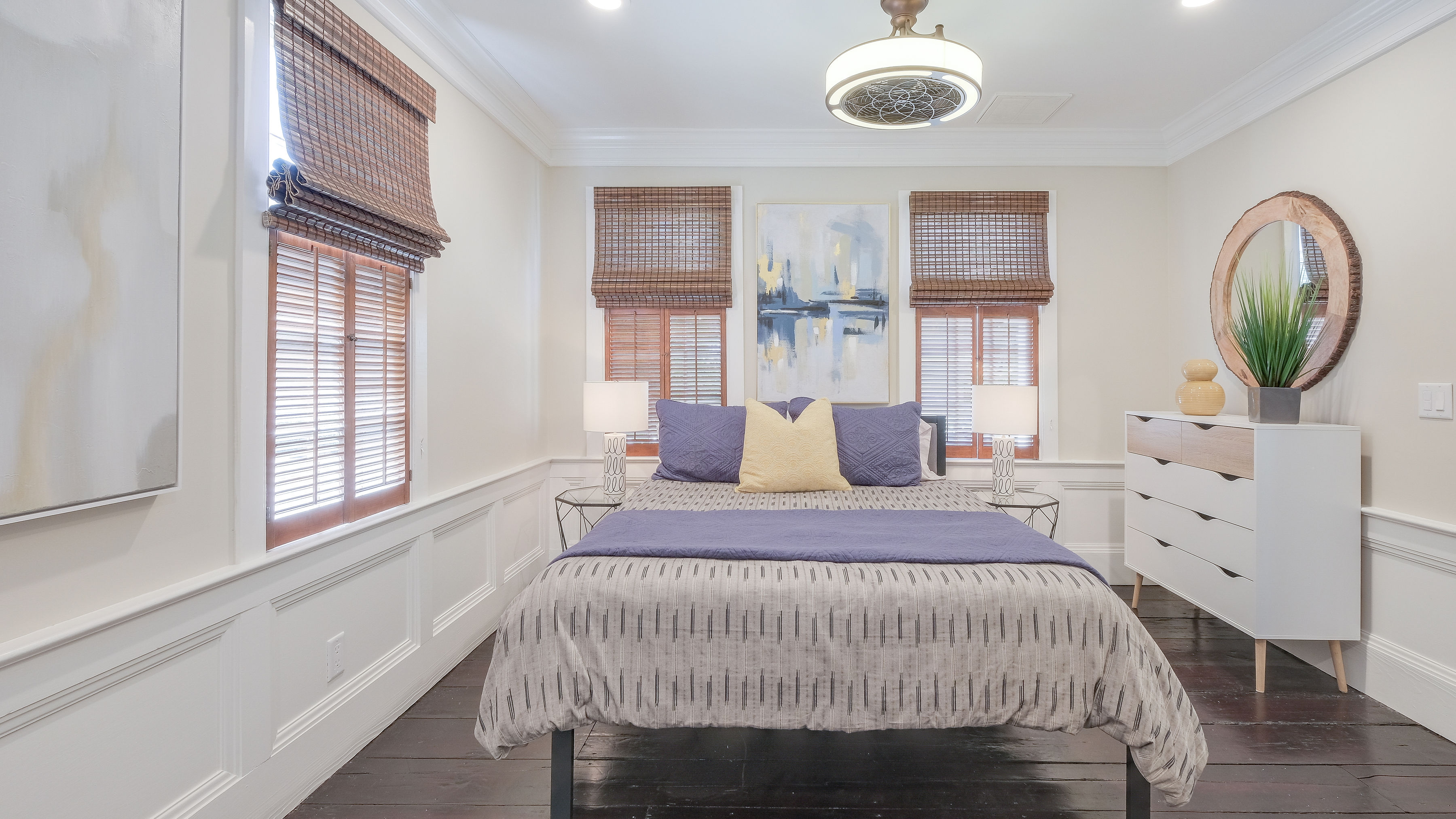 Downstairs bedroom with a queen bed