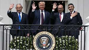Trump trumpets signing of historic accord with Israel and two Arab states