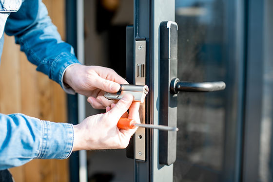 Man changing core of a door lock of the