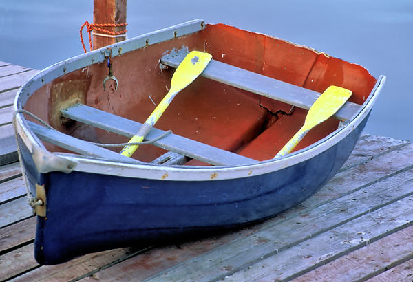 Colorful weathered rowboat painted red,