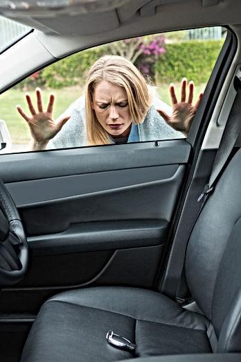 Woman forgot her key inside of her car.j