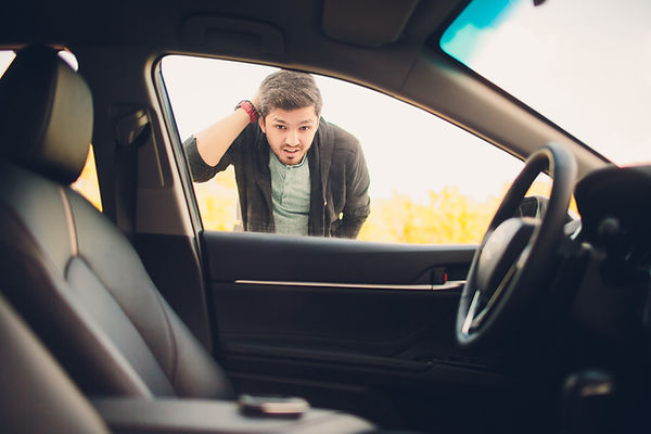 man forgot the key inside of his car.Tra