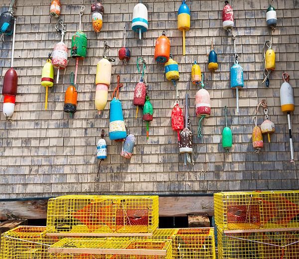 Traditional vintage lobster buoys hangin