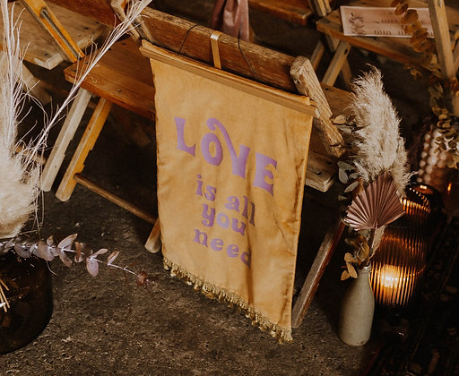 'Love is all you need' banner