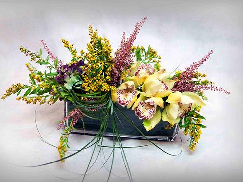 Centro de Orquídeas y flor variada