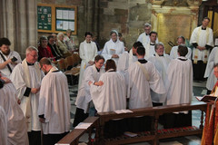 The changing the stole to be worn as a Priest