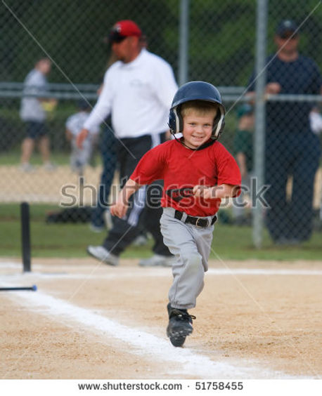 stock-photo-young-baseball-player-running-and-smiling-during-game-51758455.jpg
