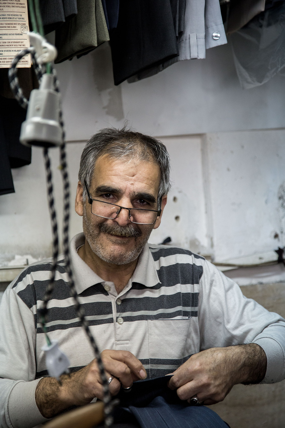 A man working at his shop near Gheytariyeh