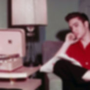 elvis-listening-to-record-player_1_orig.