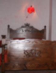 Cama doble con cabezas decorado del Padaladar, una de las habitaciones exclusivas del Festí dels Sentits