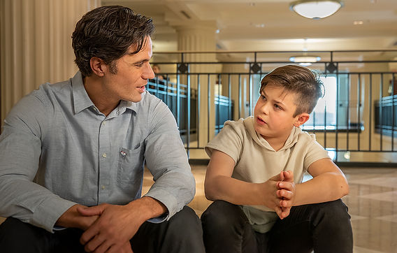Man talking with a young boy
