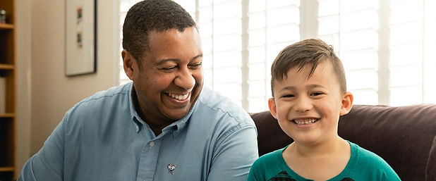 Smiling man and young boy