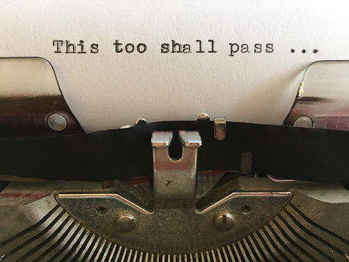 This too shall pass; text typed on white