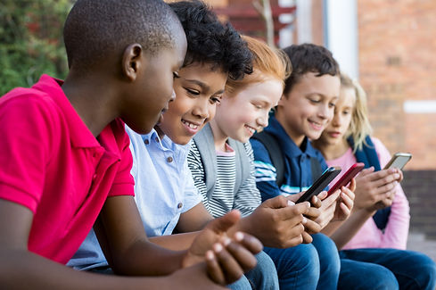 Pupils using mobile phone at the element
