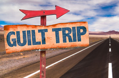 Guilt Trip sign with road background.jpg