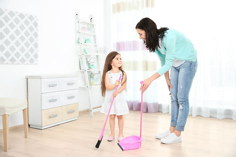 Daughter and mother sweeping together in