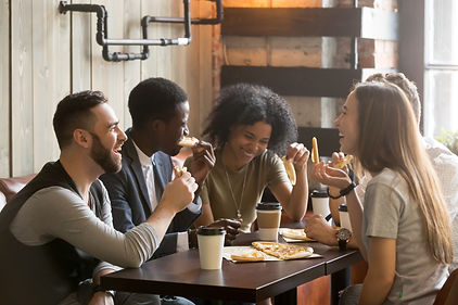 Multiracial happy young people eating pi