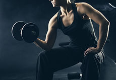 Young woman lifting the dumbbells.jpg