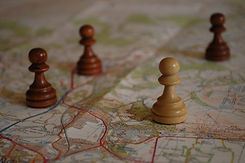 Chess Pieces on Map Depicting Strategic