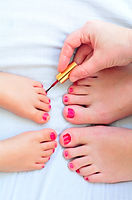 Mother And Child Paint Their Feet With Nail Polish.jpg