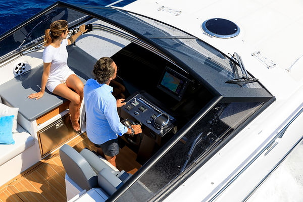 aerial view couple on luxury motor boat.