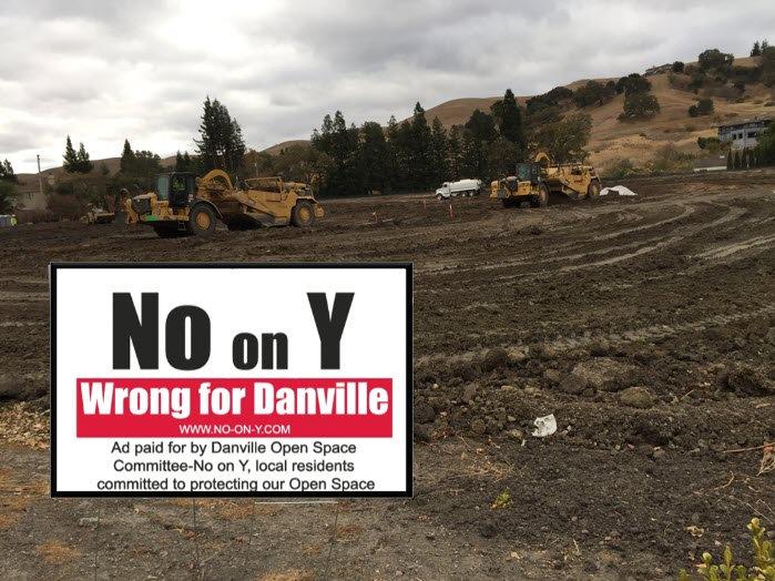 No on Y sign on bulldozed land.jpg