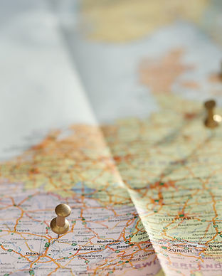 traveling-map-with-golden-pins.jpg