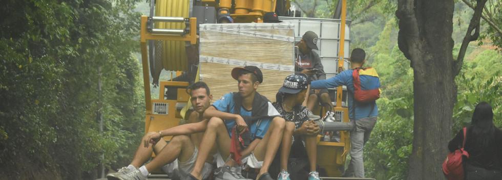 Refugees hitch a ride.JPG