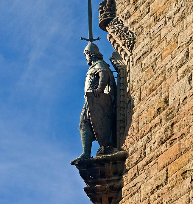 Statue of a Gallowglass knight with a sword and shield