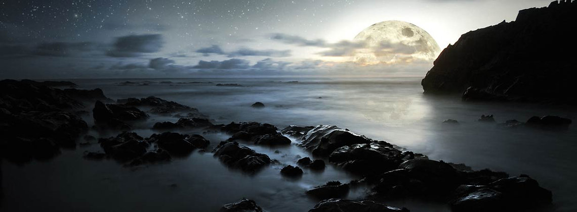 The sea lit by a large moon