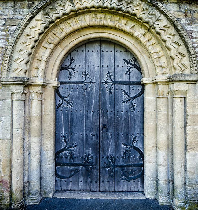 Large double doors with arches above