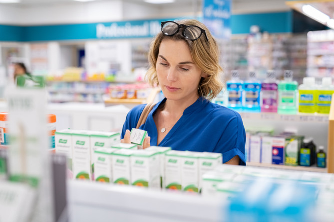 woman-choosing-product-in-pharmacy-VE9TY
