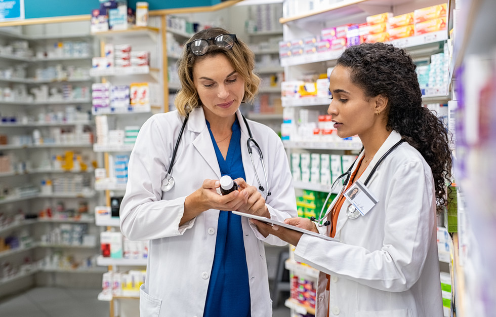 two-pharmacists-working-together-at-phar