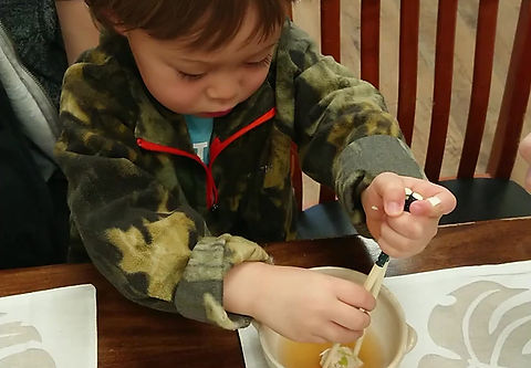 Two and a half years old using chopsticks