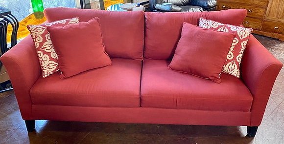 Red Sofa with Accent Pillows