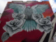 This is an image of a magestic bird painted on the exterior wall of Victoria Manor by artist David Derkatz