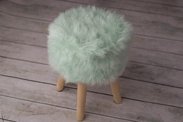 small teal fuzzy stool
