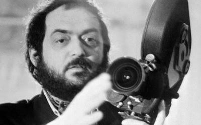 Director Stanley Kubrick holding film camera.