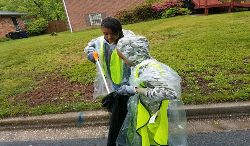 SWWYLA girl picking up trash within the Suitland community.