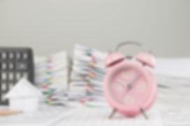 Old Pink Alarm Clock Have Blur House As Background.jpg