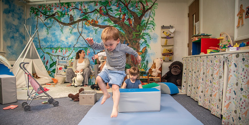 Boy jumping in jungle room